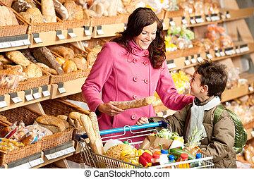 spożywczy, zakupy, -, młoda kobieta, z dzieckiem