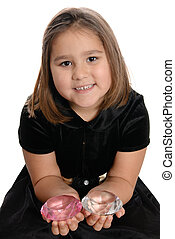 Spoiled Child - A spoiled girl is holding two large diamonds...