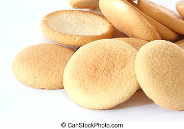 Close up view of several sponge biscuits in a heap on white background