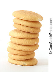 Close up view of several sponge biscuits in a stack on white background