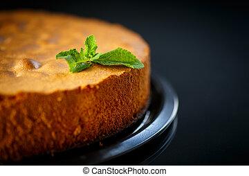 sponge cake - round cake baked on a black background