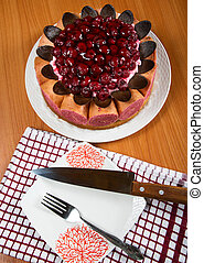sponge cake with berries close-up on table stil-life