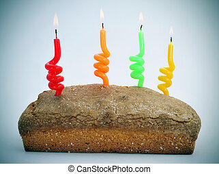 sponge cake with lighted candles