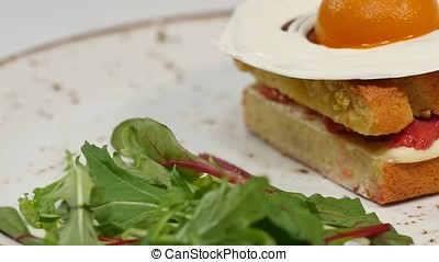 Sponge cake with strawberries, jam and whipped cream with a...