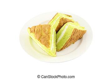 Sponge cream cake dish on white background.