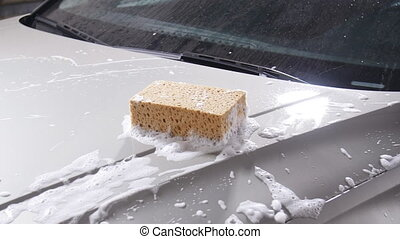 Sponge for washing cars. Car wash concept