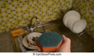 Sponge for washing dishes and gloves. - Dishwashing liquid...
