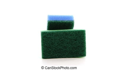 Sponges with dish washing liquid rotate on white background