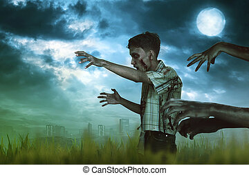 Spooky asian zombie man hand with a claw walking around