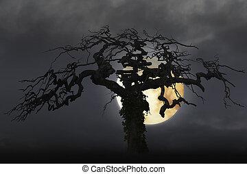 spooky bare tree on moody sky with full moon.