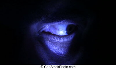 Eye lit by a blue light. Canon HV30. HD 16:9 1920 x 1080 @ 25.00 fps. Progressive scan. Photo JPG Compression. No audio.