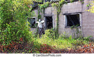 Spooky Building Complete With Scarecrow