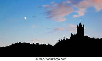 Spooky castle - the silhouette of an terrifying castle on...
