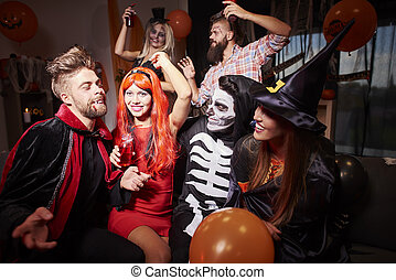 Spooky costumes at halloween friends