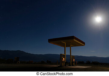 Spooky gas station at night