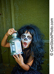 Spooky girl with lantern