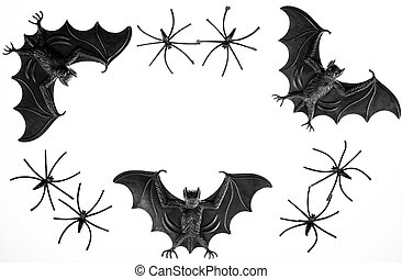 Spooky halloween border image with toy vampire bats and spiders