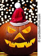 Spooky halloween pumpkin Jack O Lantern shiny inside wearing christmas hat on out of focus lights background