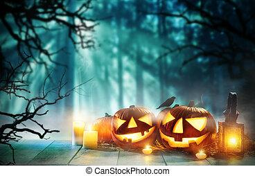 Spooky halloween pumpkins on wooden planks with dark horror...