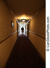 Spooky Hallway - Backlit creepy figure approaches from end...