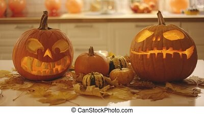 Spooky jack-o-lanterns and small pumpkins - Spooky...