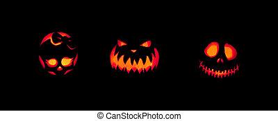 Spooky Jack-o-lanterns Outdoors - Three jack-o-lanterns...