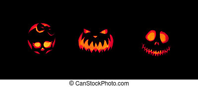 Spooky Jack-o-lanterns Outdoors - Three jack-o-lanterns...