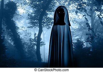 Spooky monster in hooded cloak in misty forest