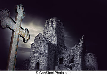 Spooky ruin with metal cross in foreground