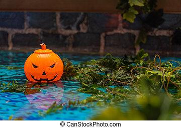 Spooky smile Halloween jack o lantern with creepy garden background