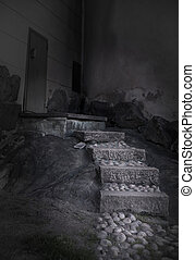 Spooky staircase leading to a closed door