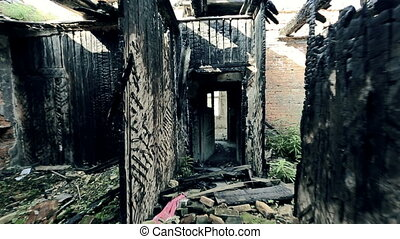 Spooky Story - Shaky camera moving along the abandoned burnt...