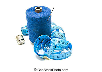 spool of blue thread with needle, meter and thimble