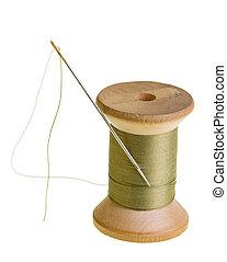 Spool of green sewing thread