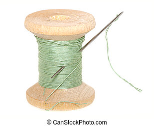 spool of thread - old wooden spool of thread with needle...