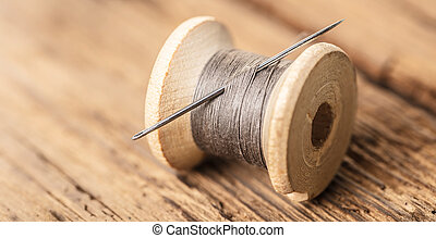 spool of thread with a needle