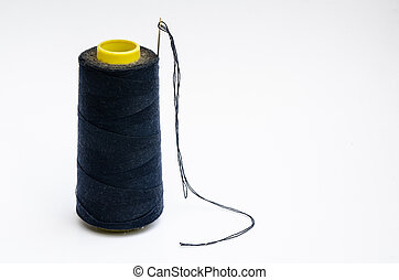 Spool of thread with needle isolate on white background