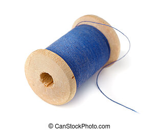 Wooden spool of blue thread isolated on white