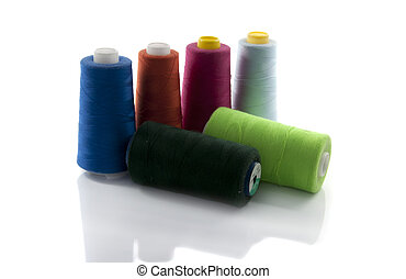 spools with cotton for manufacturing and sewing