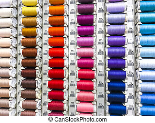 Spools of colored sewing thread