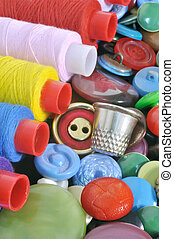 Spools of colored thread and a thimble