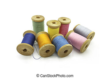 Spools of multi-colored threads on a white background