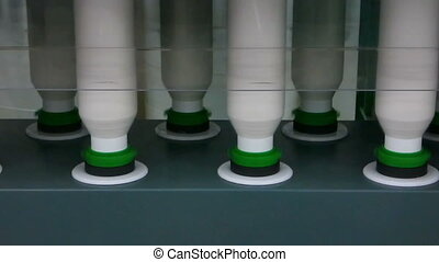 spools of thread at a textile factory