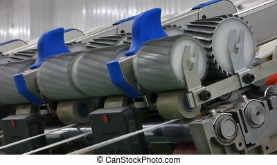 spools of thread at a textile factory - Machinery and...