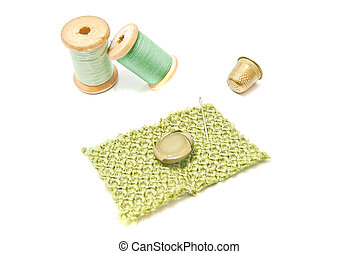 spools of thread, button and thimble
