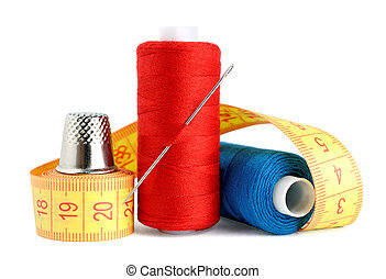 Spools of thread, needle, measuring tape and thimble...