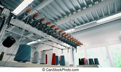 Spools of thread on knitting device view - Spools of thread...