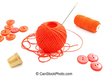spools of thread, thimble and red buttons