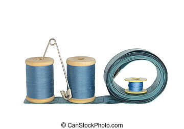 spools of thread with a ruler on a white background