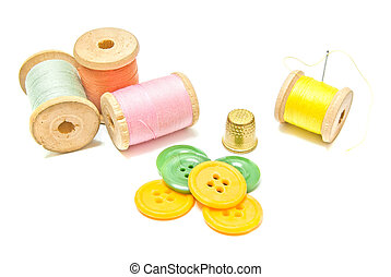 spools of thread with buttons
